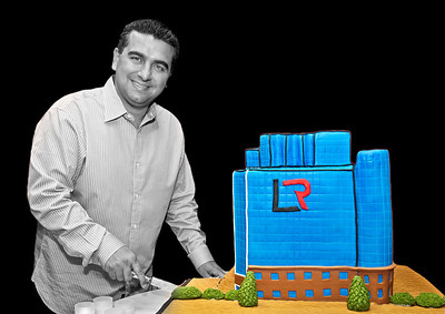 Business portrait of Buddy the Cake Boss cutting a cake of a blue building with the initials LR on it Alex Kaplan Photographer https://professionalheadshots.com