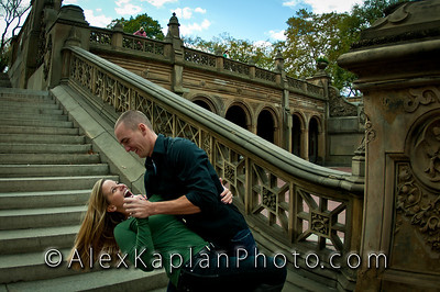 Man wearing a green shirt dipping his wife also in a green shirt as they both share a laugh in front of stone steps  Alex Kaplan Photographer https://professionalheadshots.com