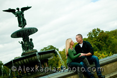 Couple sitting on the edge of a fountain holding each other hands while smiling at each other by Alex Kaplan, photographer http://www.alexkaplanphoto.com