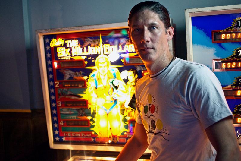 Zanzabar co-owner Antz Wettig proudly showcases his latest addition: a vintage Six Million Dollar Man pinball machine.