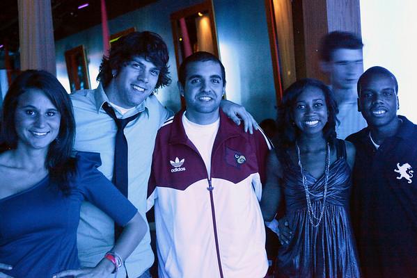 Candace Burk, Troy Shortridge, Payvand Rakhsha, Aly Mudd, and Adrian Frazier soak up some blue light in the corridor.