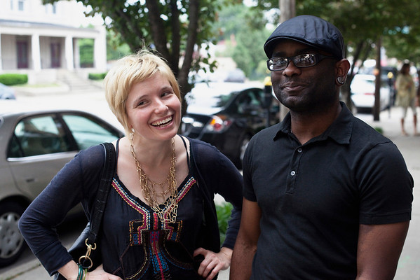 Kirby Coleman and Megan Wiley share a laugh on the sidewalk.