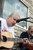 Bruce Gordon and Steve Hammond played on the sidewalk near Mayan Cafe.