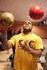 Kelvin Moore showcases his juggling skills with a set of bowling balls during the Goodtimers Soul Bowl on Saturday night. (Photo by Marty Pearl)