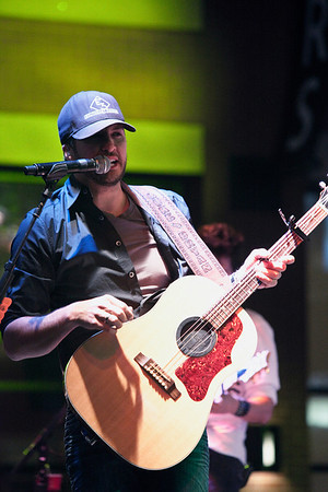 Country music star Luke Bryan took to the stage with his band at Fourth Street Live to play for an enormous and enthusiastic crowd. (By Marty Pearl, Special to the Courier-Journal) April 29, 2010