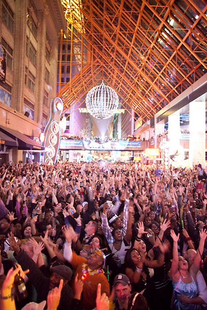 The ceremonial ball drops from the rafters of Fourth Street Live and revelers  commence in celebration with cheers, kisses, and lots of noise.