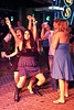 Emma McQuill, Maggie Keenan, and Brandi Ernspiker dance until the music stops.