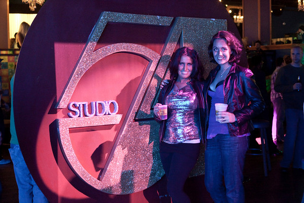 Ruth Domanek and Grace Deer pose in front of the Studio 54 sign.