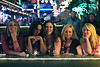 LaDonna Jamison, Susan Brown, Shawna Grazier, Jessie Hennessey, and Carrie Keys bask in the warm glow of neon light on the smoking deck.