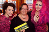 Celena Olliges is sandwiched by Kynt and Vyxsin for a fan photo.
