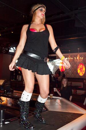 Jess Driggers dances on the bar.