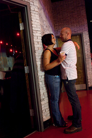 Love is in the air (or maybe it's just the Mens Room next to them.)