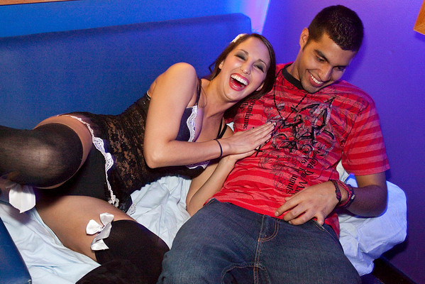 Amy Grant and Luis Silva take advantage of the makeshift beds during Bedtime Stories at Hotel Night Club.