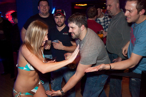 Chelsie Crume dodges the over zealous affections of her bowling fans.
