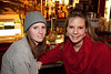 Ally Schamaun and Emily Tidor hang out near the bar.