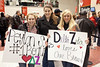 Addina-Marie Saltsman, Shelly Nelson, and Jill Whoberry show their love for UofL's Peyton Siva.