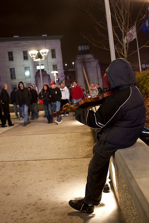 A miniature violinist entertains the pre-game crowds at the KFC Yum Center.