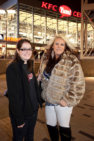 Patricia Randolph and Gabby Dixon trek through the cold night to see the game at the Yum Center.