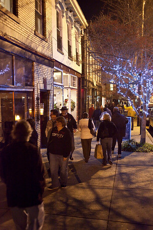 East Market Street was bedecked in holiday color as pedestrians gathered again for the First Friday Trolley Hop through the NuLu district.