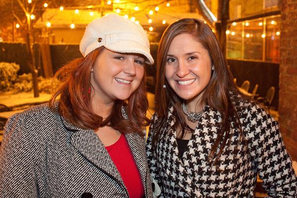 Rachel Hart and Kristina Kolb get some fresh air at Flanagan's.