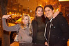 Shauna Duehmly, Jessica Guelda, and Xavier Martinez get happy in the snow shower along Baxter Avenue.