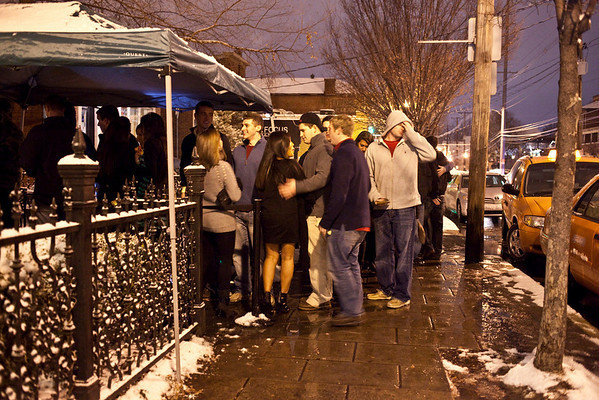 The line at O'Shea's increased as the snow decreased.