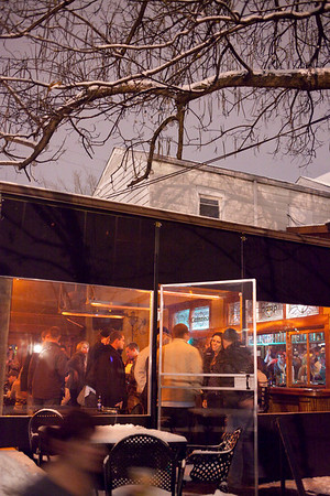 The usual open-air atmosphere of O'Shea's Tavern was modified to fight mother nature and accomodate the crowds.