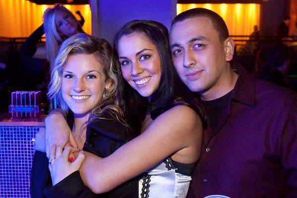 Megan Howlett, Bridget Bryant, and Adam Conn like a group hug.