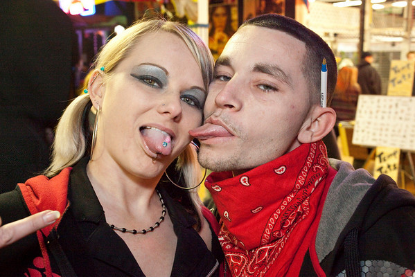 Megan Layton and Bryan Underwood do a little tongue-wagging.