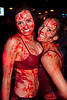 Tracy Zellers and Lauren Pfeiffer smile through the Jell-o after battling each other.