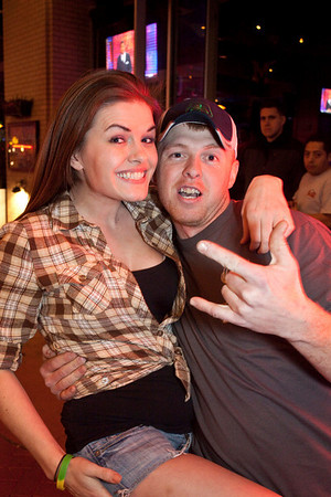 Ryan Purvis of Trumansburg, NY loves the Louisville night life, and Amy Denny of Sports and Social Club is happy to indulge him with a photo.