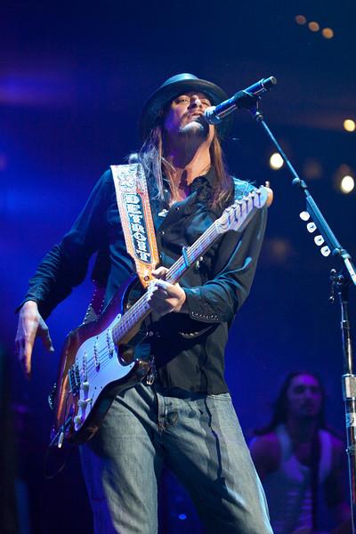 Kid Rock breaks out the guitar.