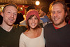Ben Collins, Courtney Leahigh, and Adam Center hang out near the bar.