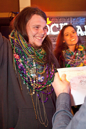 Robert Horine learns he has won the bead contest with a total of 196 (beating second place by a single strand.)