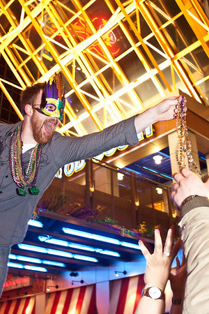 WDJX's Ben Davis kept the crowd hyped with a liberal dispensing of the beads.