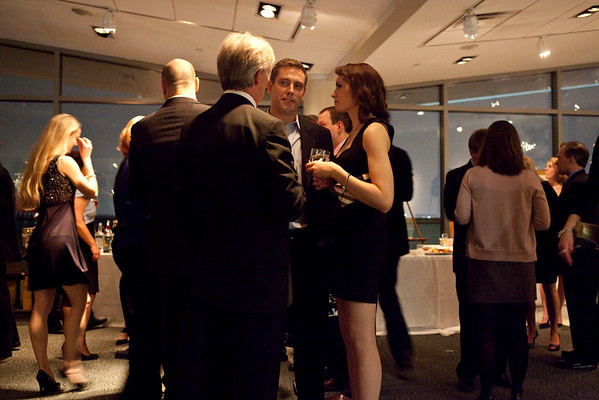 Conversation buzzed through the room as guests enjoyed live music and assorted liquors.