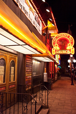 The sidewalks of Baxter Avenue hit their brightest spot when you near the legendary Phoenix Hill Tavern.
