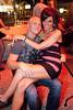 Colleen Schauman gets chummy with pal Marc Denham.