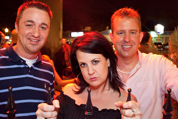 Nicole French lures people into the Molly Malone's courtyard with her serious gaze. Mike Melhiser and Jason Hayes prefer the smile.