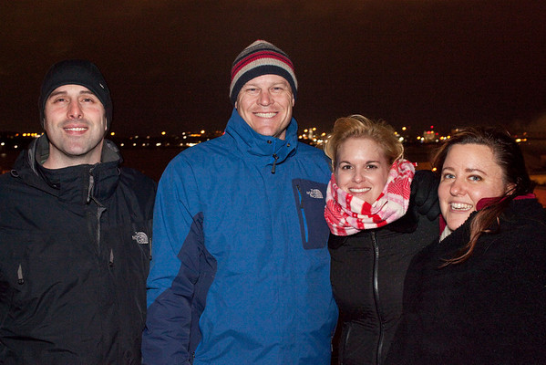 Mike Daversa of Seattle, Washington joins Andy and Julie Stottman and Sarah McCauley for some roof top viewing.