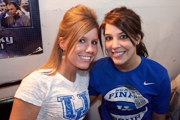 Nicole Wick and Amanda Schneider find a nook to watch the game.