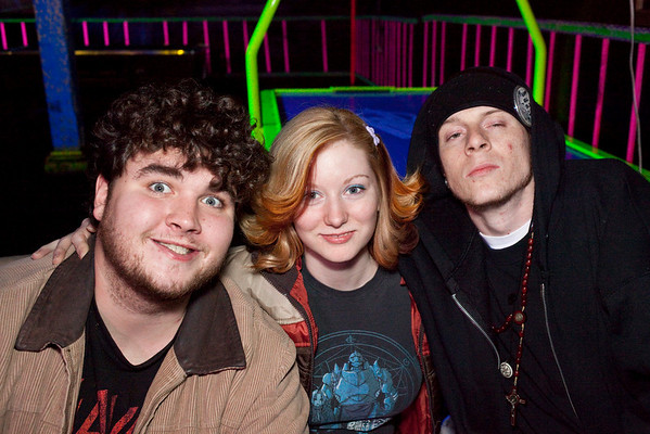 """Zak Wilson and Sara Carey show their enthusiasm for being photographed with rapper """"Tha Warlock"""" (right) before his performance at Expo Five."""