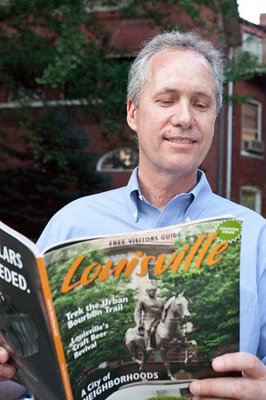 The Mayor checks out the new Louisville Visitors Guide.