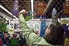 Artist Scott Scarboro hangs a few more pieces for sale.