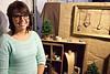 "Artist Annie Waltke of ""Found in the Attic"" proudly displays her work."