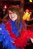 Kirby Feldkamp rocks a few colored boas from the costume shelf in the karaoke room.
