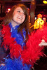 Kirby Feldkamp rocks a few colored boas from the costume shelf in the karaoke room.