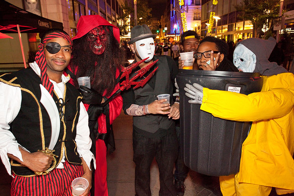 Random scenes and various faces in the crowd at the Fourth Street Live Halloween Party.