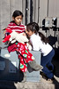 Mini-volunteers Avani and Naya Singal take a moment to inspect the toys being given away.