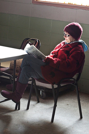 Patricia Cantrell finds some good light to sit and read a book.